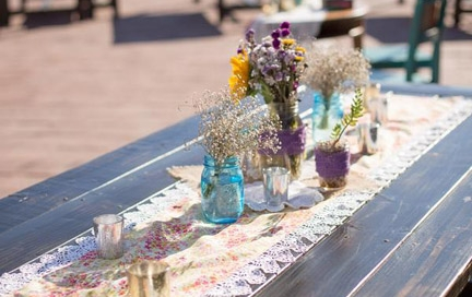 Ocean views over wooden table rentals by Rustic Events. Photography by Ashley Bee Photography at The San Clemente Historic Cottage, San Clemente, Orange County, CA.