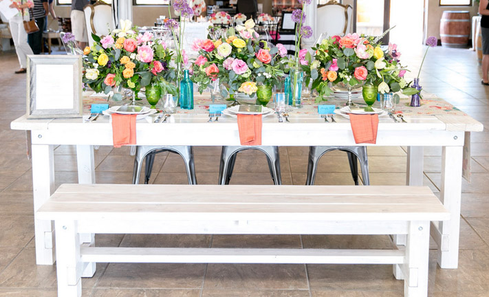 Spring colors over white picnic table rentals by Rustic Events. Photography by Leah Marie at Danza del Sol, Temecula, CA.