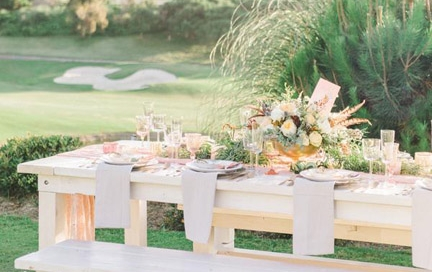 Luxurious golf resort and ocean views with whitewash tables and benches for wedding or picnic table rentals by Rustic Events. Photography by Meghan Elise at St Regis Monarch Beach, Dana Point, CA.