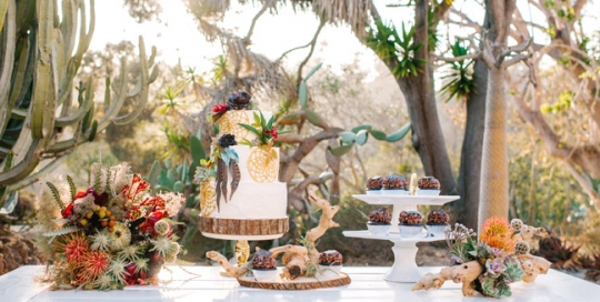 White sweetheart picnic table rental by Rustic Events and featured in San Diego Style Weddings magazine. Photography by Chris and Don MacAskill at the Old Cactus Garden in Balboa Park, San Diego, CA.