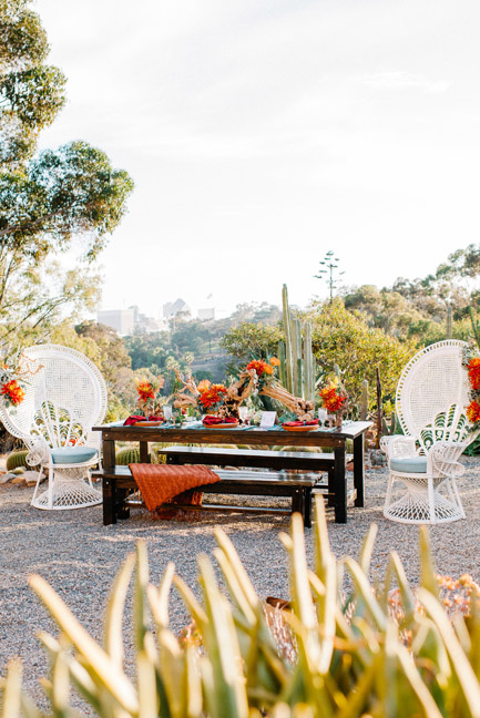 San Diego skyline behind rustic farm tables for rent from Rustic Events. Featured in San Diego Style Weddings, October 2015. Photography by Chris and Don MacAskill at The Old Carcut Garden, Balboa Park, San Diego, CA.