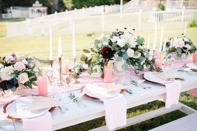 Light blush decor and pink lemonaide on Rustic Events white picnic tables for weddings. Photography by Chris and Don MacAskill at Windmill Ranch, Escondido, CA.