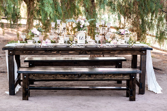 Wood tables and bench rentals with vintage décor at the Ranch House in Los Penasquitos. Photography by Pauline Conway.