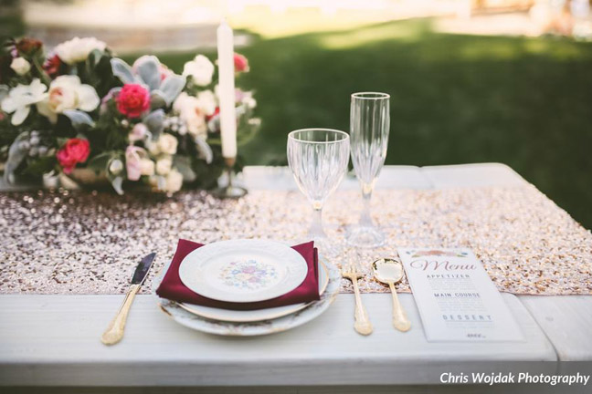 Whitewash picnic table rental with vintage plates. Photography by Chris Wojdak at the Historic Adobe in Vista, CA.