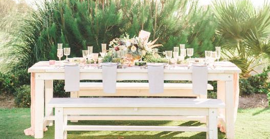 Beautiful whitewashed picnic tables for rent with large matching white benches. Photography by Meghan Elise at St Regis Monarch Beach in Dana Point, CA.